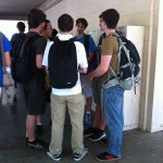 A cluster of students stand in front of the S-wing lockers during break. Students often choose to chat directly in front of their lockers, making it very difficult for others to access theirs.