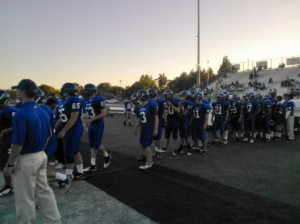 DHS Varsity football shake the hands of their opponents after a victory of 62-0 on September 7