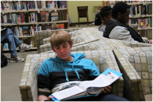 Davis High sophomore Jacob Fields studies for an upcoming World Civilizations test in the Davis Public Library while blasting classic rock.