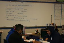 Juniors Alexis Ceceñra and Guillerno Rodriguez study with tutor Luis Salgado in their ELD 2A class on Dec. 4. Although the ELD class is offered to English learners, not all take the class.