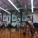 The women's varsity basketball team shoot hoops for practice during half time. The worsens varsity basketball team won their first game jan 8 with a final score of 69 to 28