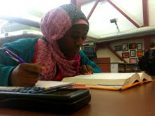 Photo Caption: In this photo illustration senior Nafisa Eltahir studies during lunch on Dec. 3 in the library. Eltahir and her mother left Sudan for a better education system in the U.S and Eltahir studies at lunch to take full advantage of this.