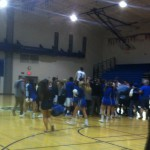 DHS fans storm the court after the varsity men's basketball team's win over Monterey Trail on Senior Night