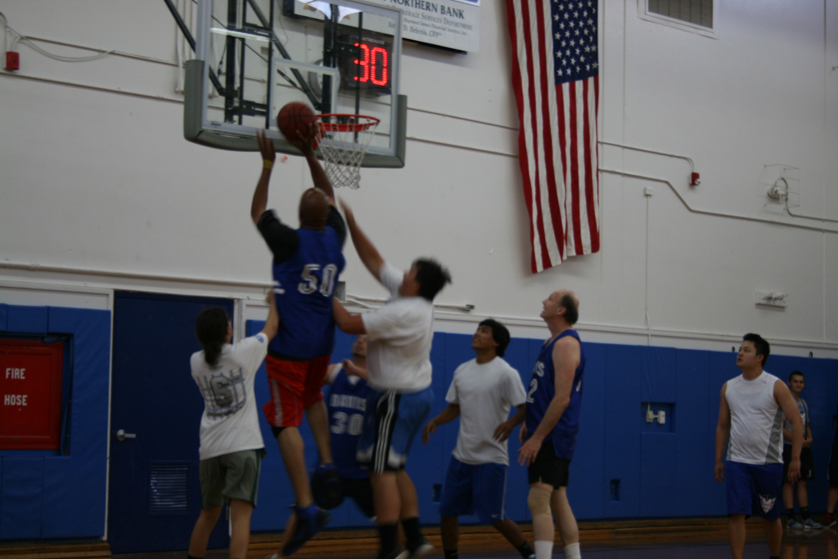 Demond Huff shoots the ball as students defend against him in the students-vs-staff basketball game in the old gym on May 7, 2013.
