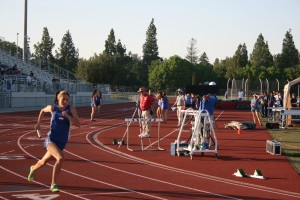 Senior Laney Teaford sprints the 4x4 for Women's varsity at the last home track meet of the season.