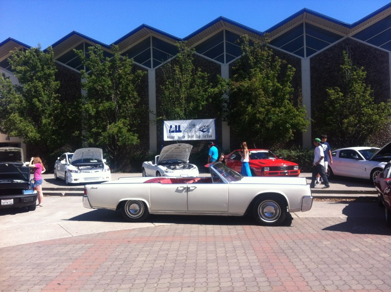 Students gather in the quad Wednesday, May 29 at lunch as the Davis High School car club hosts its annual car show.