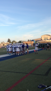 Davis High lacrosse players huddle together during an exciting game against Granite Bay. The Blue Devils win 10-9.