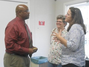 New Davis High Principal, William Brown, engages staff in a conversation on Monday, June 10, at a meet and greet at the district office.
