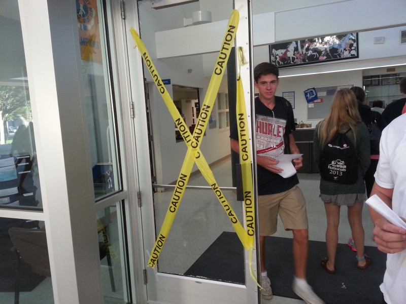 The main office door shattered on the first day of school. Photo by Skyler Blume.