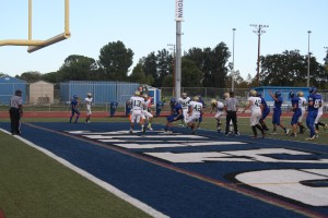 Quarterback Jack Beckman scores on a six yard run against Rio Americano. Beckman finished with three total touchdowns. Photo by Kyle Clancy, HUB Staff.