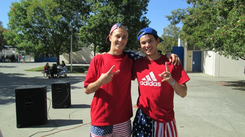 Student government members Jeff Stark and (name) show their school spirit for America Monday on Oct. 7. Student government organizes every aspect of homecoming, including spirit week.