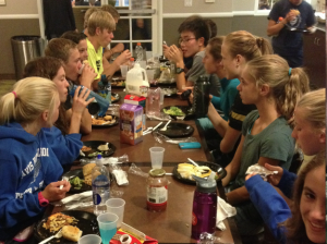 DHS cross-country members enjoy platefuls of pasta and glasses of chocolate milk on October 11 as they prepare for the Clovis Invitational. Many of the runners see this trip as an opportunity to bond with their teammates.
