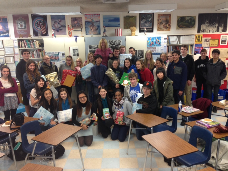 Neagley's fourth period class poses with some of their gifts before they're sent off. Photo courtesy of Mrs. Neagley.