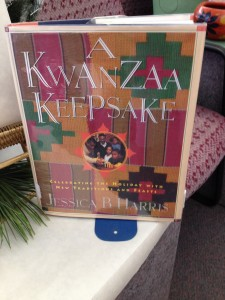 Kwanzaa book that can be found in the DHS library stand next to other winter holiday decorations.