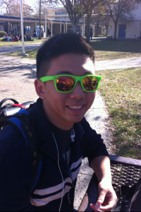Senior and DHS Idol competitor Dustin Choi sits at a table in the school quad during lunchtime.