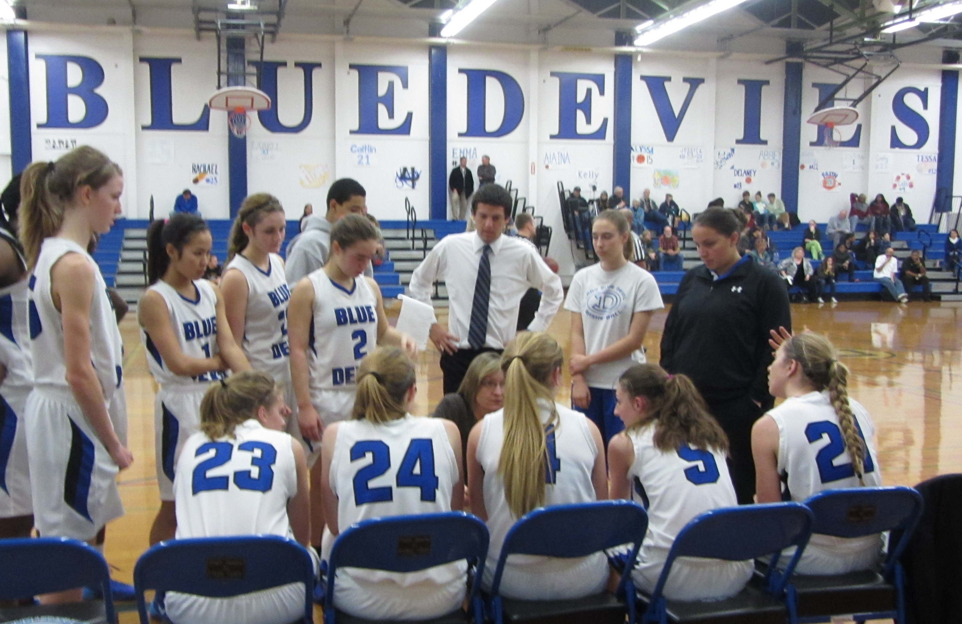 The DHS women's varsity basketball team huddles during a break in its Jan. 9 game. Davis lost 55-66 to El Camino.