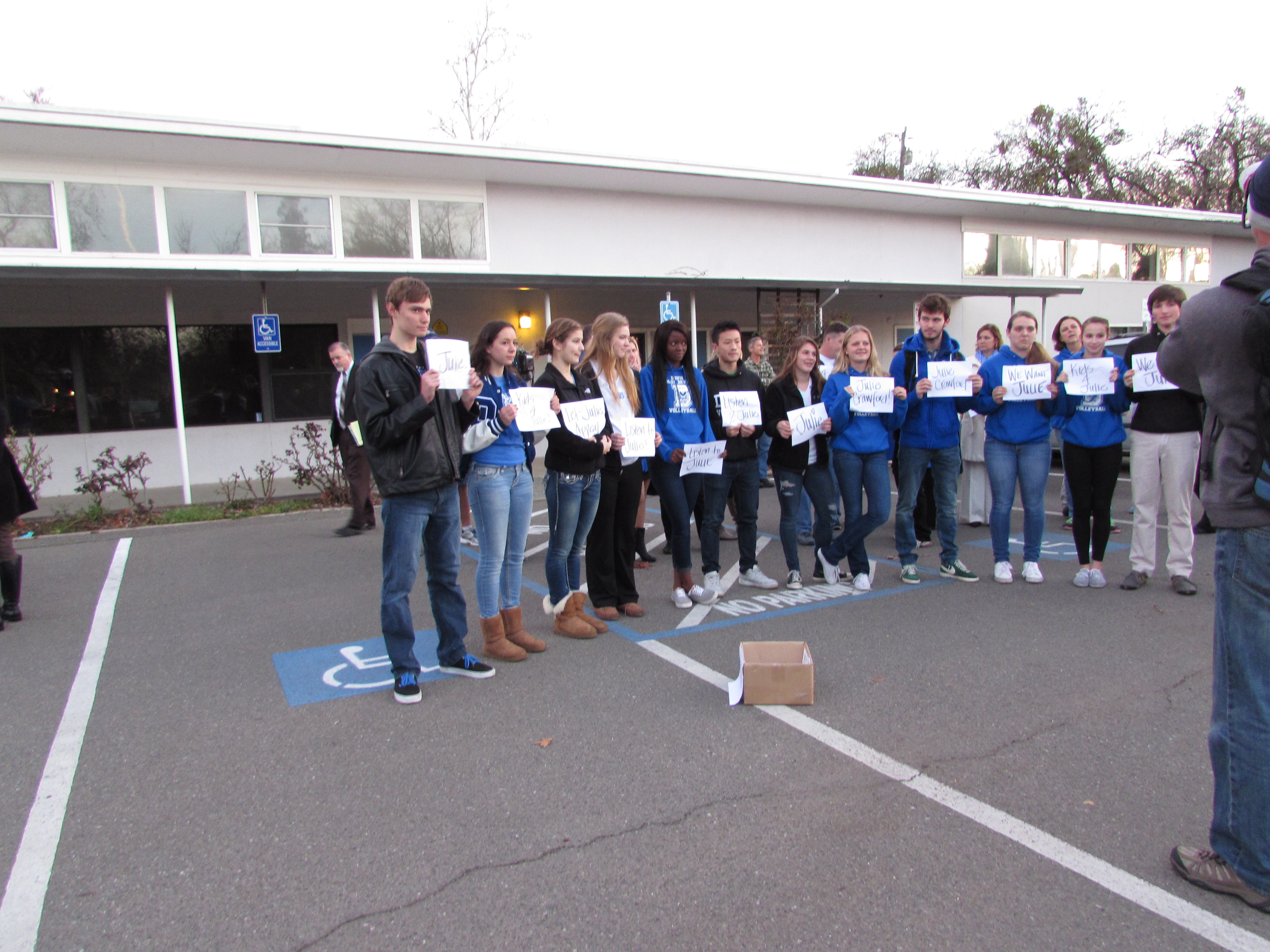 DHS volleyball players protest for Crawford's appeal.