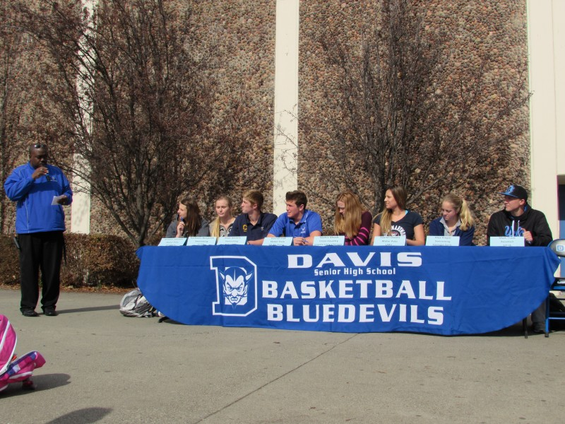 Senior athletes commit to their future colleges on the quad on Feb. 5, National Signing Day. Photos by Zach Hertz.