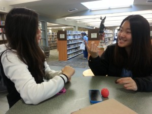 Jennifer Park helped Yoo shortly after Yoo came from Korea. Occasionally, they go to the library after school. Photo by Djajapranta.