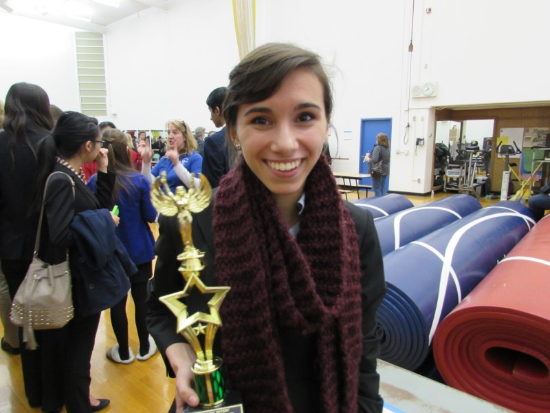 Junior Camila Ortiz poses with her trophy after placing second in Dramatic Interpretation.