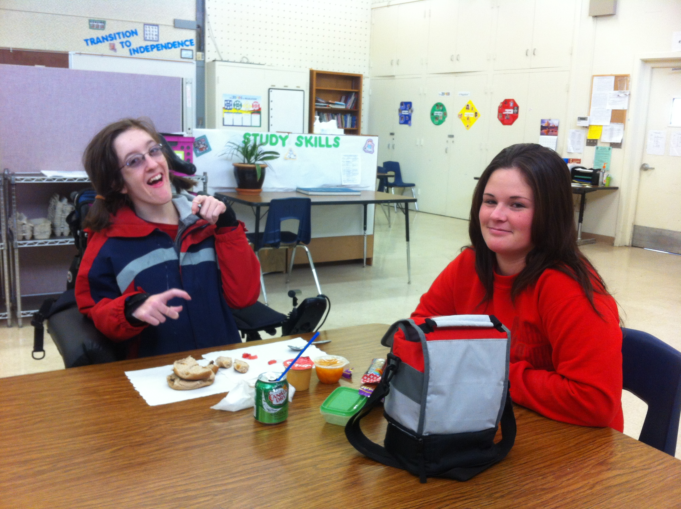 Junior Jessica Roeckl-Navazio eats lunch in classroom M1 with her paraeducator. Her paraeducator, Nichole Spiva, has been working at DHS for three months.