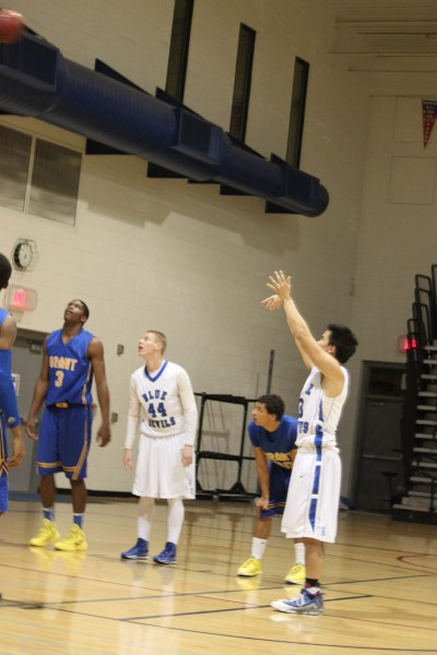 Senior Ben Crook shoots a free throw during the varsity men's senior night on Feb. 18. Photo by Zoe Juanitas.