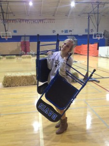 Senior Brooke Palmer is seen carrying chairs to help set up for the dance. All photos by Rana Eser.
