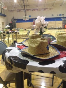 Tables are adorned with cowboy hats to capture the western theme