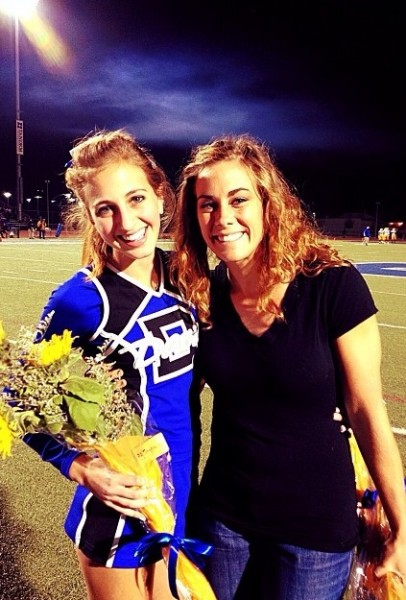 Former Cheer Coach Danielle Eckert poses with senior Rana Eser at Senior Night earlier this year. Courtesy photo by Rana Eser.