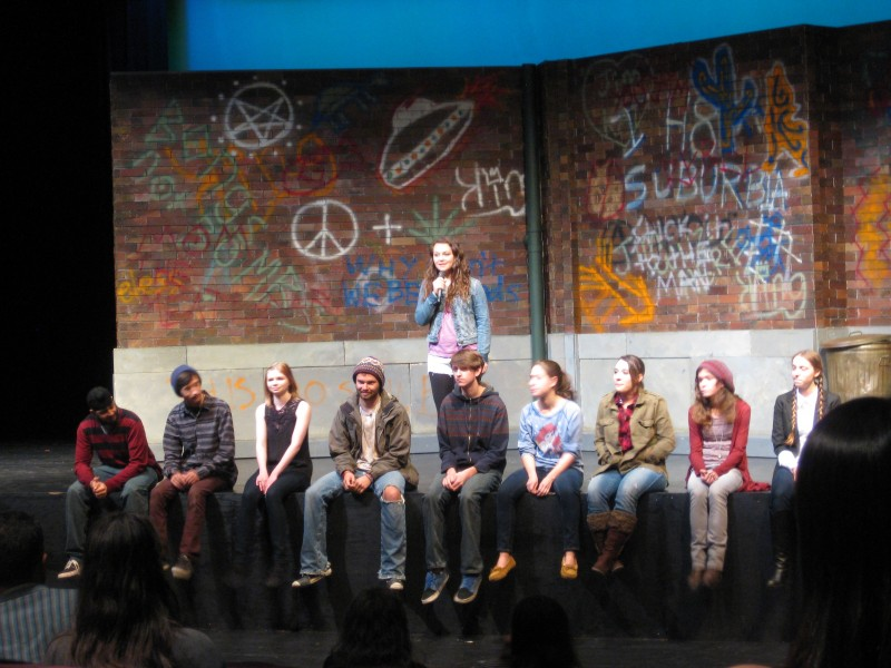 Junior Sydney Maguire leads the talk-back discussion with members of the cast who answered questions about the play on March 15.