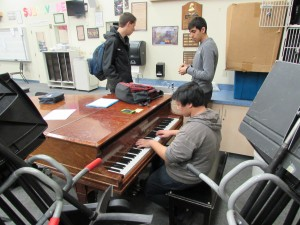 Junior Jezreel Real practices piano during lunch for fun and to keep up his skill.
