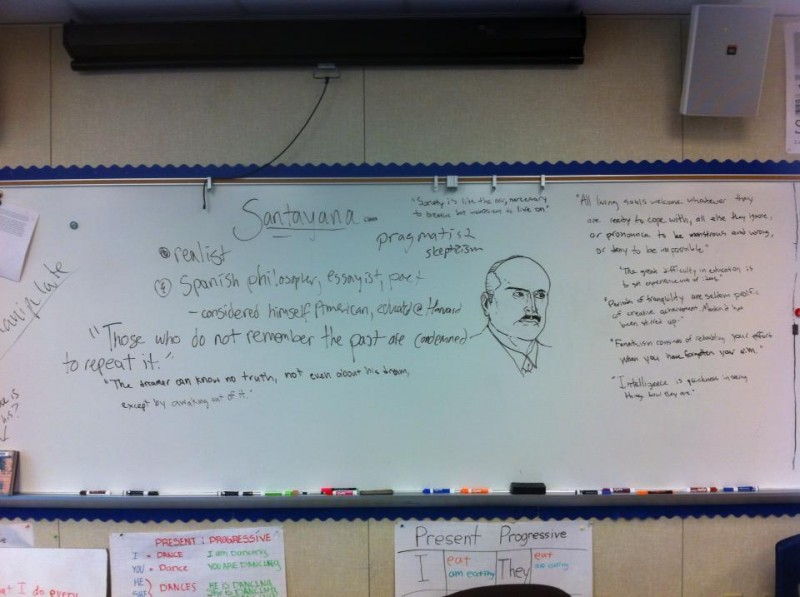 Philosophy Club members write and take notes on the whiteboard at their meetings in P-21.