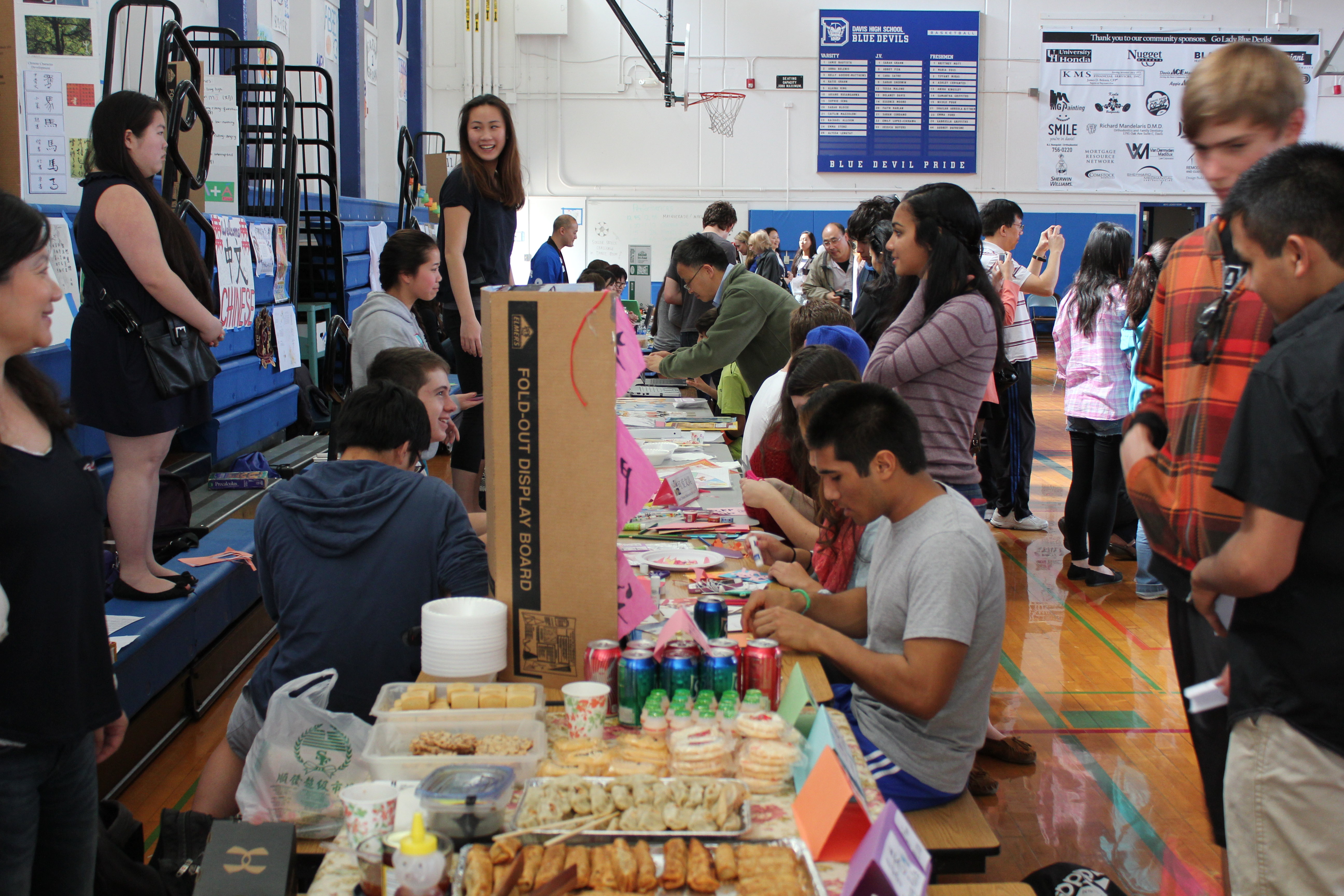 Students and other members of the Davis community take part in the various arts and crafts offered at the DHS World Language Fair while other clubs sell traditional food from the culture associated with their club's language