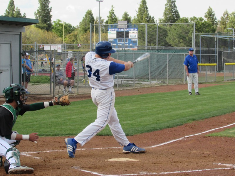 Senior Matt Trask takes a hard swing at the ball in the 12-1 Devil victory against Monterey Trail on April 3.