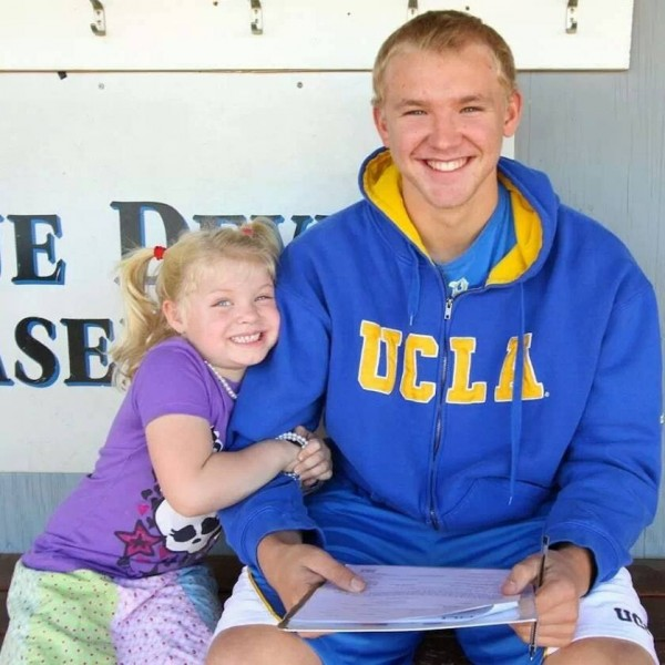 Trask smiles with his little sister while signing his national letter of intent and committing to playing for the UCLA Bruins.  Courtesy photo from Trask.