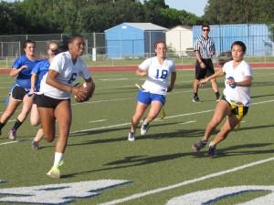 Junior Brittany Aldredge helps the junior team achieve their first touchdown.