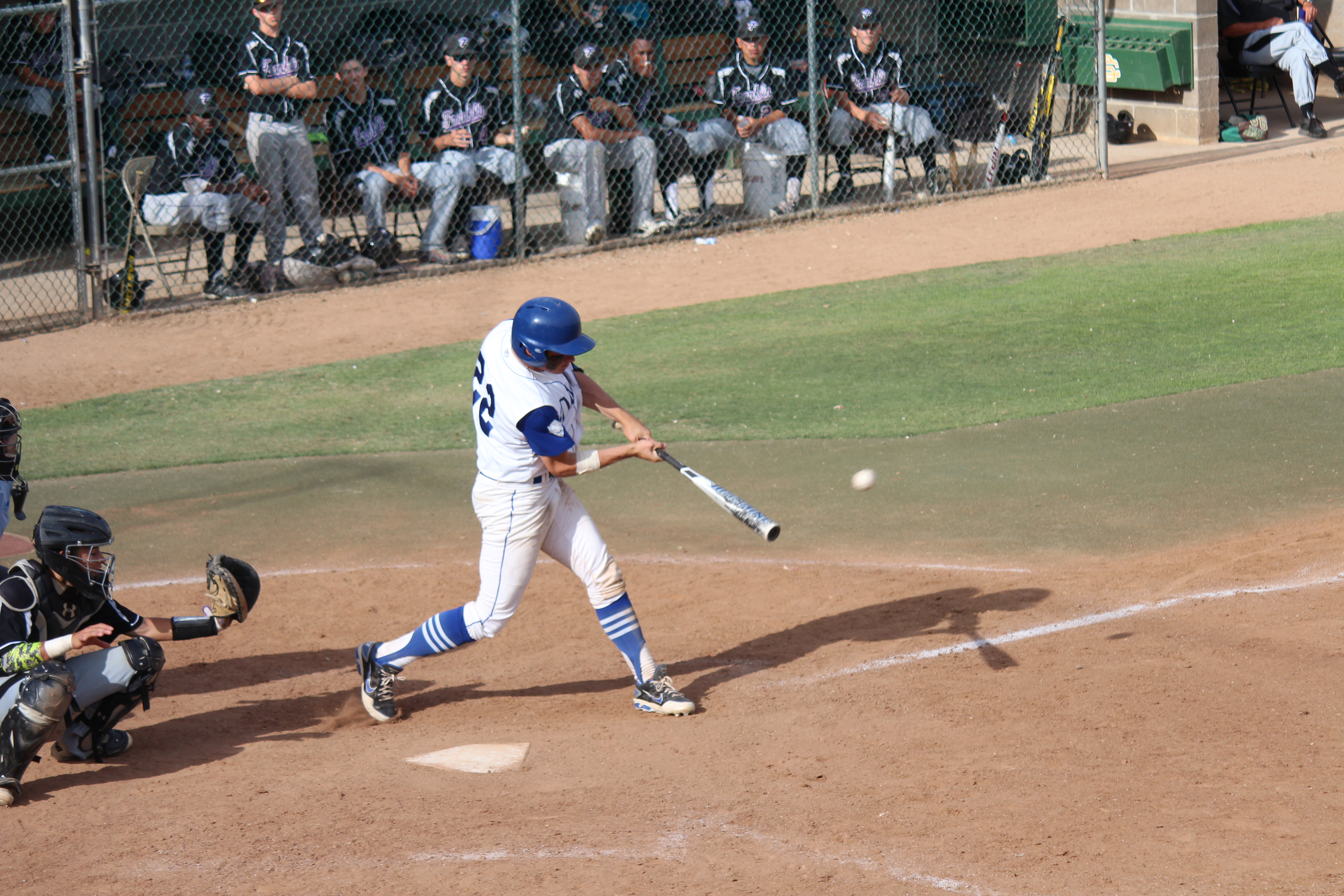 Senior John Ariola strokes a hit in Satuday's matchup against Franklin High School. Ariola went 2-4 in DHS' game against Rocklin.