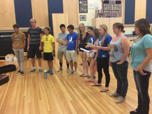 """The senior choir rehearses """"100 Years,"""" which it will be singing at graduation."""