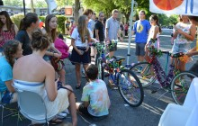 Teens of all ages converse as they participate in the bike decorating contest.
