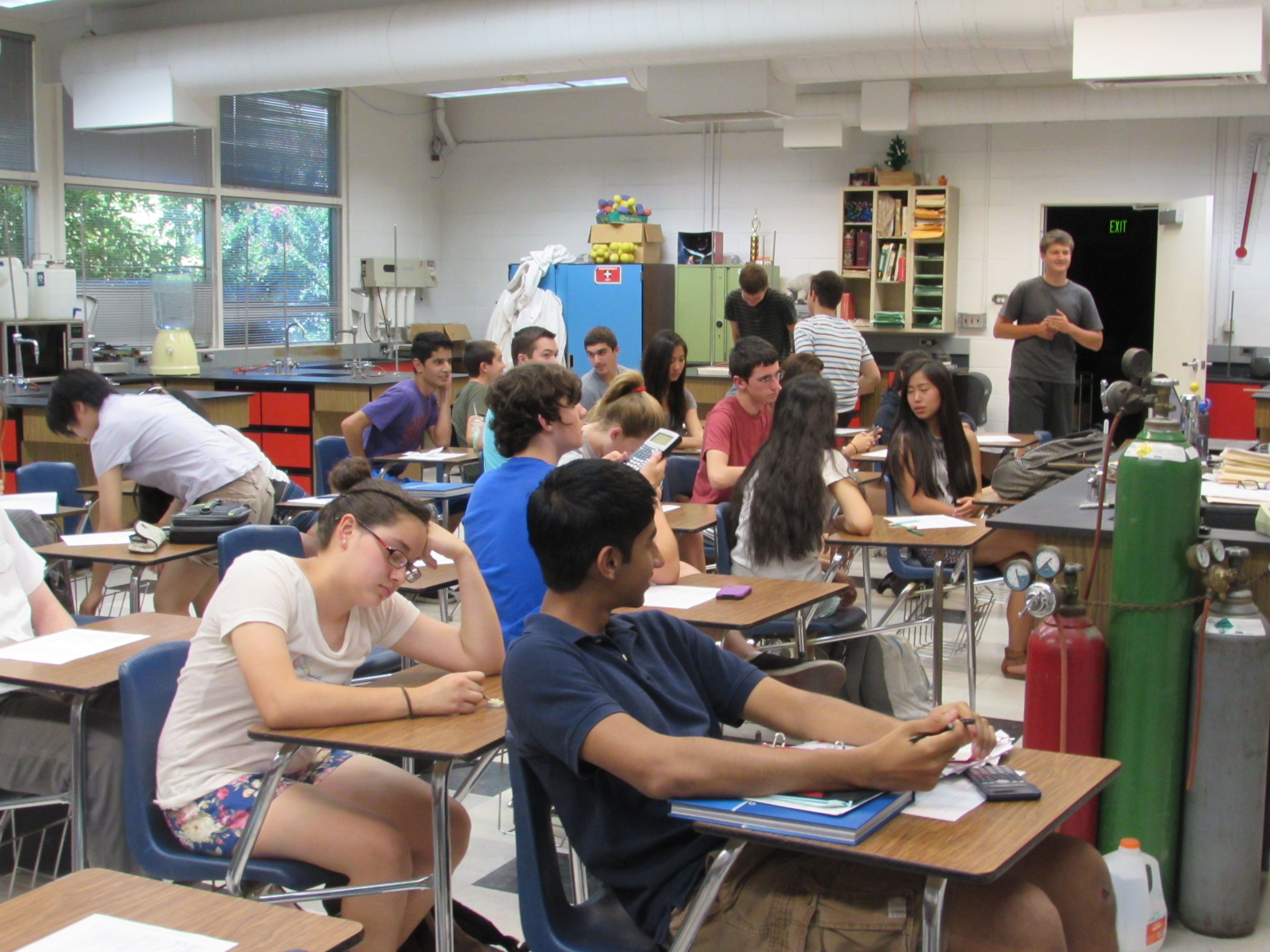 Students in David Van Muyden's 7th period Chemistry class wait to have their tests passed back in June of 2014.