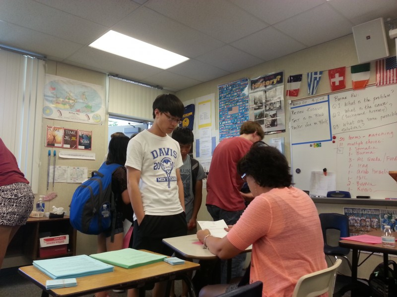 Fern O'Brien, the adviser of Davis High's California Scholarship Federation, registers senior Wilson Xu for the new CSF semester. Registration is held at lunchtime in Room P-13 until Thursday, Sept. 25.