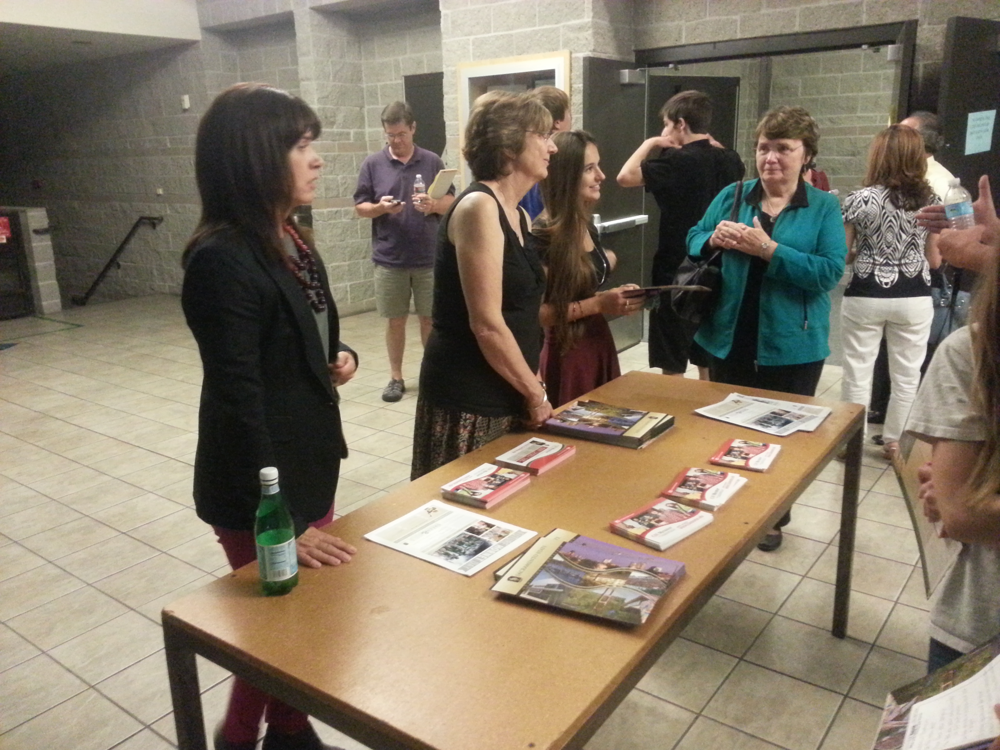 Counselors hand out brochures on the different California State Universities. The CSUs hosted a workshop at the Brunelle Theater on Sept. 18 set prospective applicants on the right track with their applications. Photo by Cliff Djajapranata.