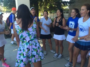 Junior Angela Donahue leads the pre-game cheer to rally the women's tennis team before its match on Sept. 8