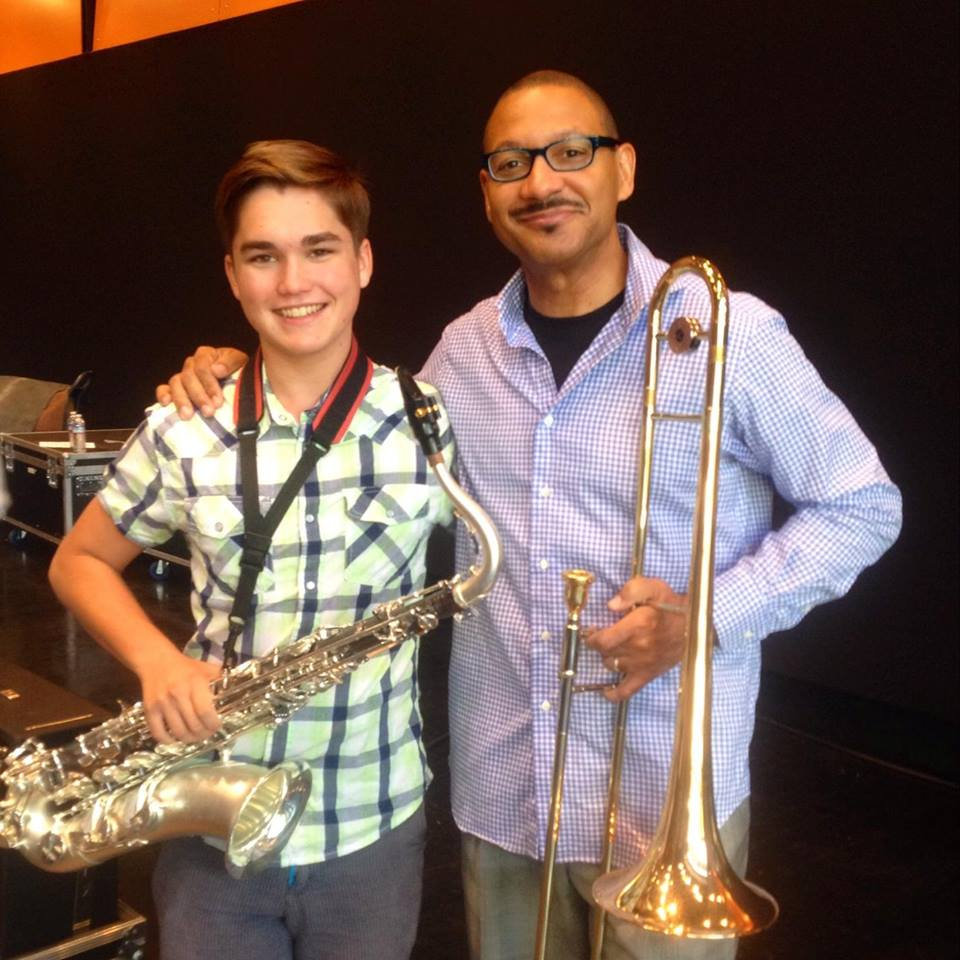 Da Vinci junior Kyle Horn poses with renowned jazz trombonist and record producer Delfeayo Marsalis shortly after Saturday's clinic. Horn plays the tenor saxophone for the DHS Jazz Band. Courtesy photo by Kyle Horn.