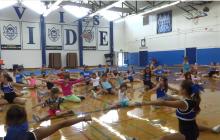 Davis High Cheerleaders host youth clinic