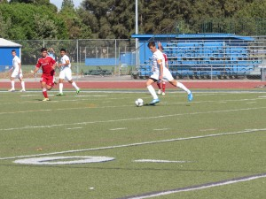 Senior and team captain Joe Rainer controls the ball during the Devil's 3-1 victory over Jesuit