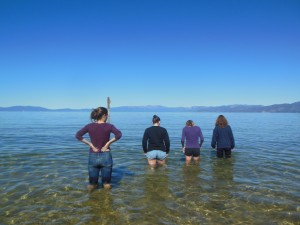 Seniors Danielle Schlenker, Kelly Strickland, Meg Robinson and Giulia McIsaac wade into Lake Tahoe on the last stop of the environmental science field trip. Students were granted an hour to rest on the beach and in the water before returning to Davis.