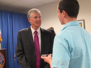 Bodenfor (right) asks Torlakson (left) a question after the conference.