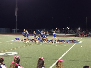 The cheer seniors pose at the end of their halftime routine at senior night on Oct. 24. Photo courtesy of Anna Verdiguel.