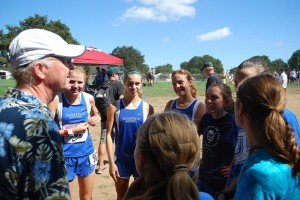 Castiglioni and her teammates meet with coach Bill Gregg during the 2014 Stanford Invitational meet.
